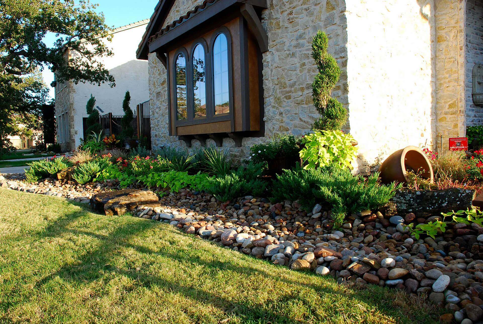 garden landscaped with rocks and plants