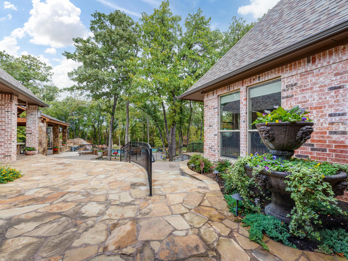 stone patio and landscaping by lawn connections