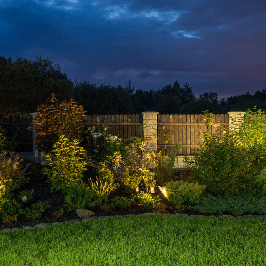landscape lighting and garden at night that was designed and installed by Lawn Connections