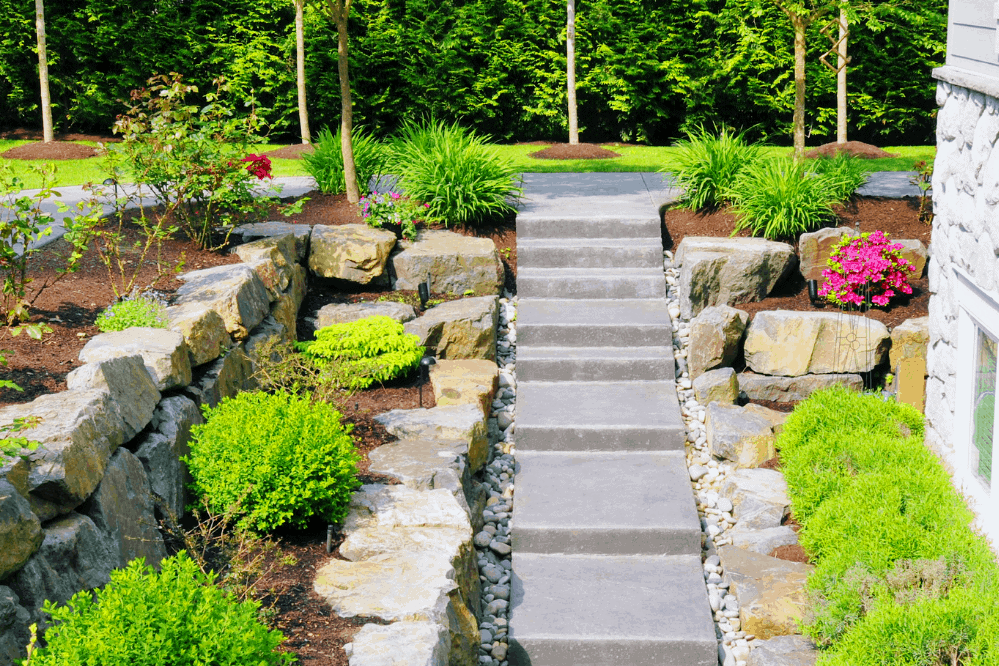 stone pathway and landscaping that was designed and installed by Lawn Connections